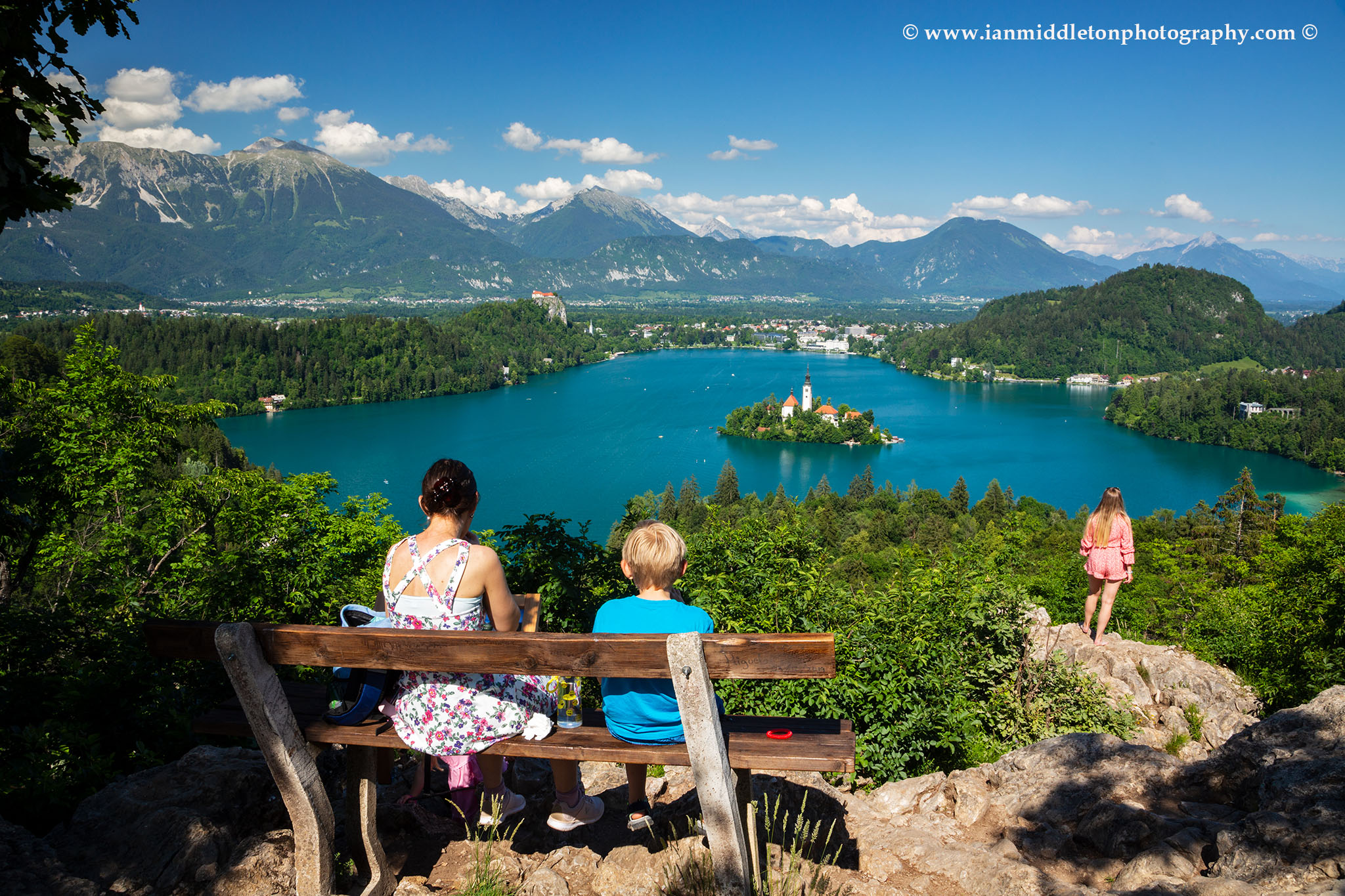 Enjoying the view across Lake Bled to the island church and clifftop castle from Ojstrica, Slovenia.